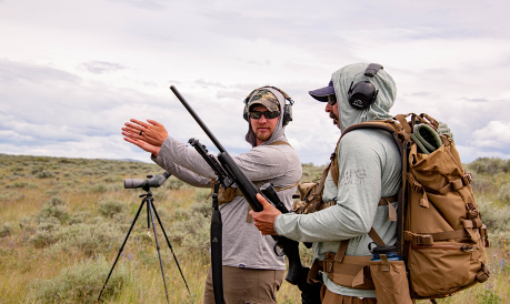 Firearm instructor Jake Jourdonnais discusses shooting tips with MPG Ranch staff member Mike Ormandy during the first annual advanced shooting course at MPG Ranch on June 11, 2020.