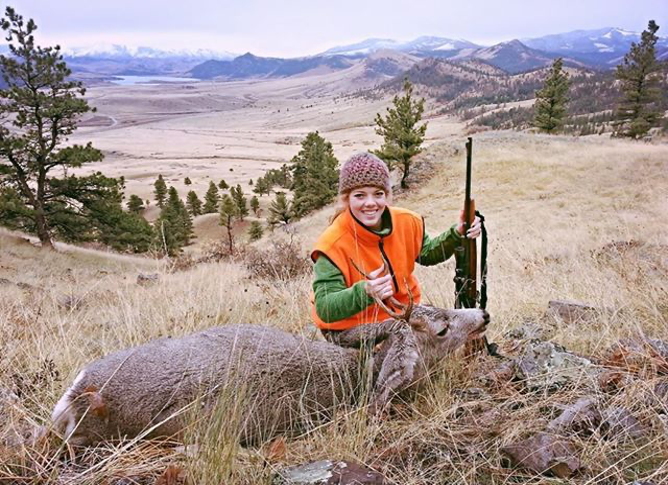 A Montana hunter poses with her first mule deer buck