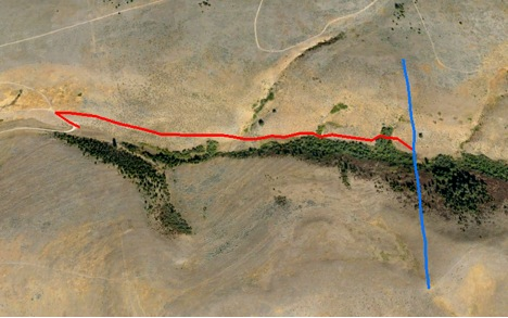 The blue line indicates the fence removed. The red line shows the route used to haul out materials.