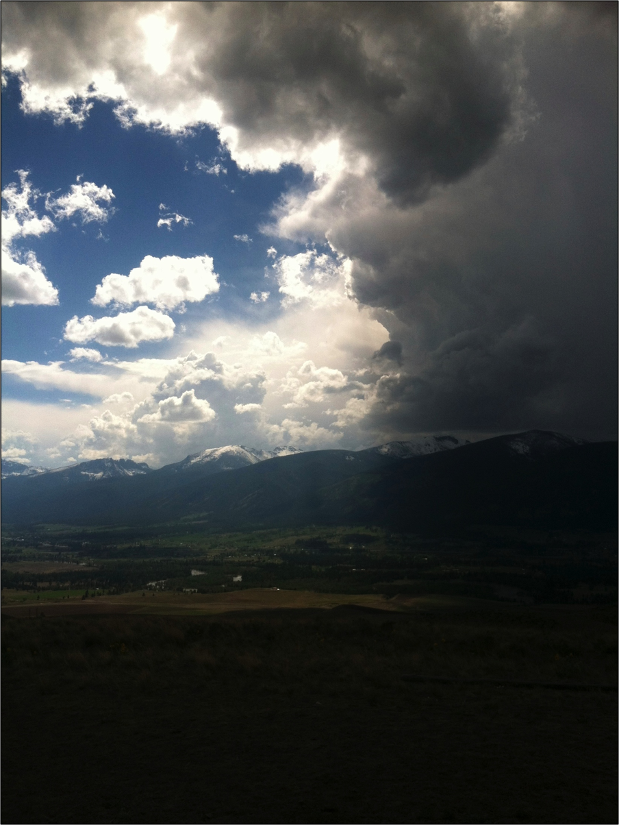 Storm clouds break over the Bitterroot Valley, creating perfect conditions for raptor escape.