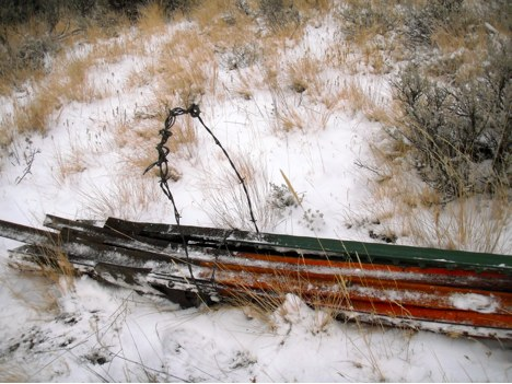 Volunteers bundled the t-posts  and made handles out of barbed wire to drag the posts out.