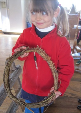 .  Emaline proudly holds her base made from shrub branches and spurge shoots.
