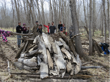 Students broke into teams to construct shelters from material available on the floodplain. Both teams opted for lean-to's built from the ample supply of driftwood.