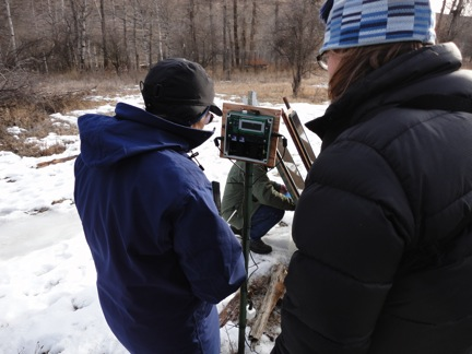 Debbie Leick helps Kristi Dubois program the unit so that it just records at night.